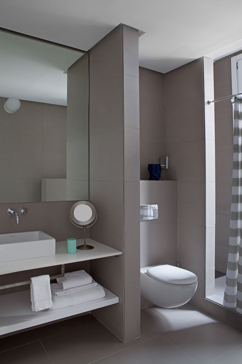 The bathroom is soothing and minimalist.