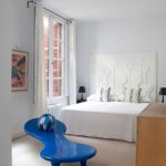 The bright blue bench is the focal point of the room.