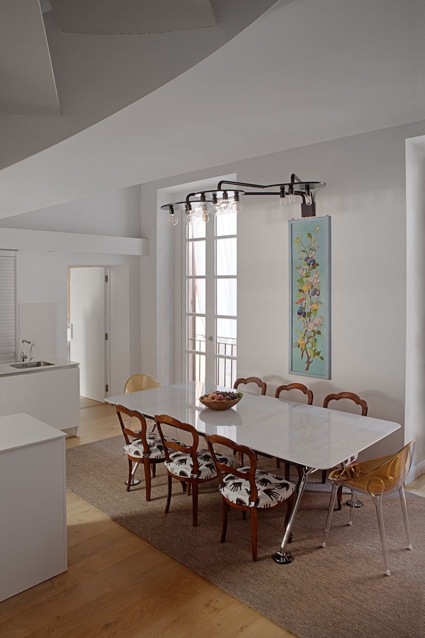 Whimsical fabric on the chairs adds a light touch to the kitchen dining space.