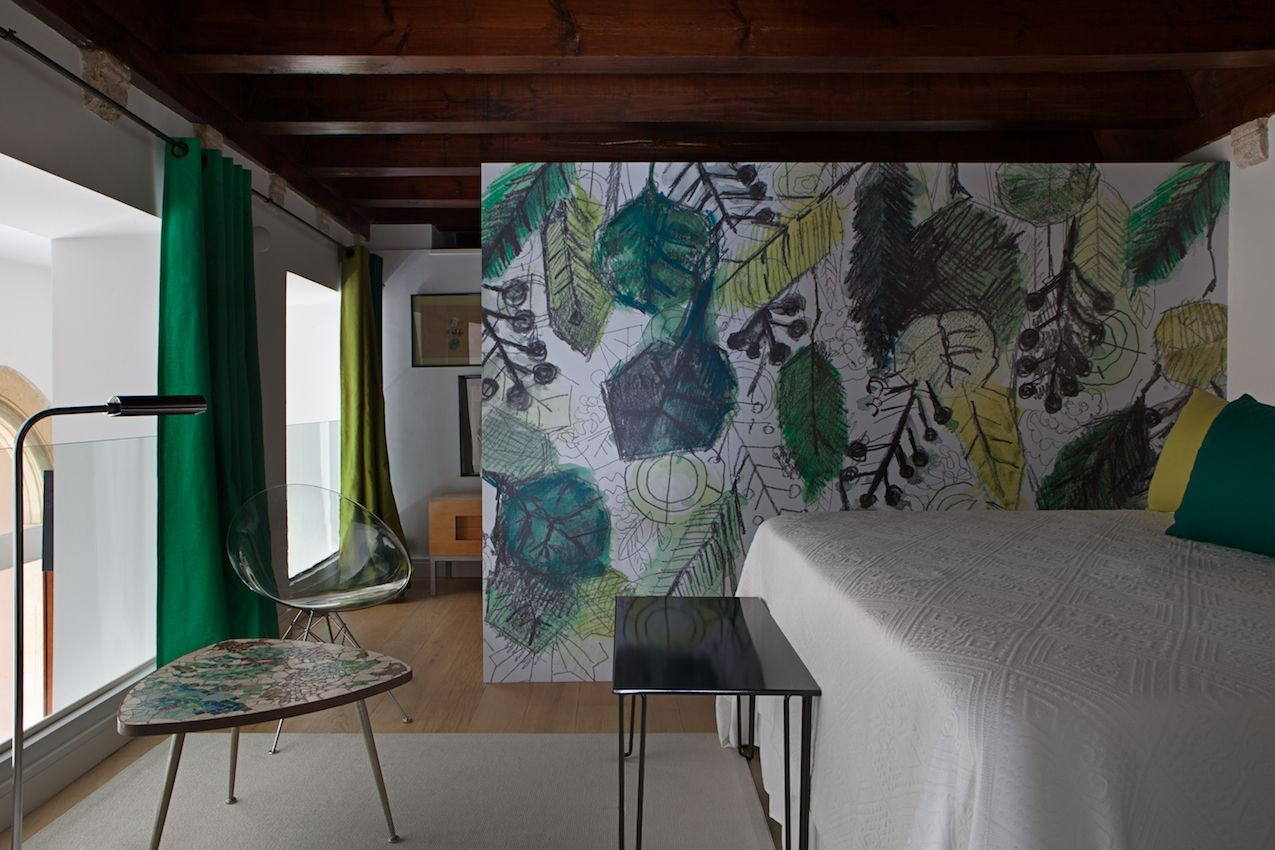 The mural is a creative and artful way to divide the room.