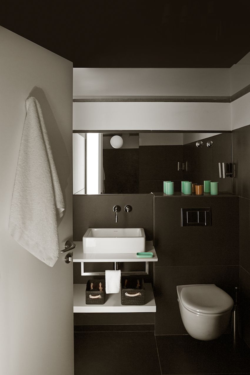 Another bathroom has a darker brown palette.