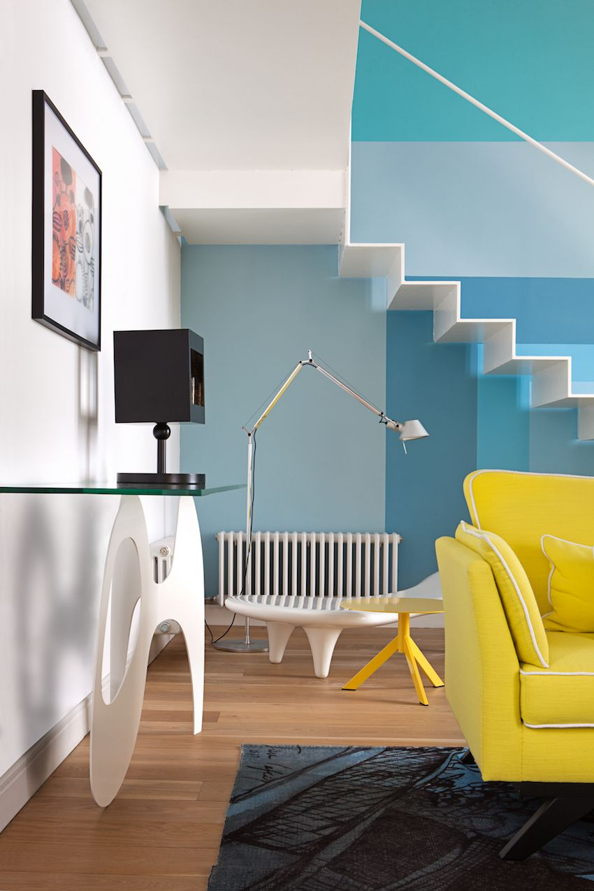Modern furnishings mix well with the bold colors used on the wall.