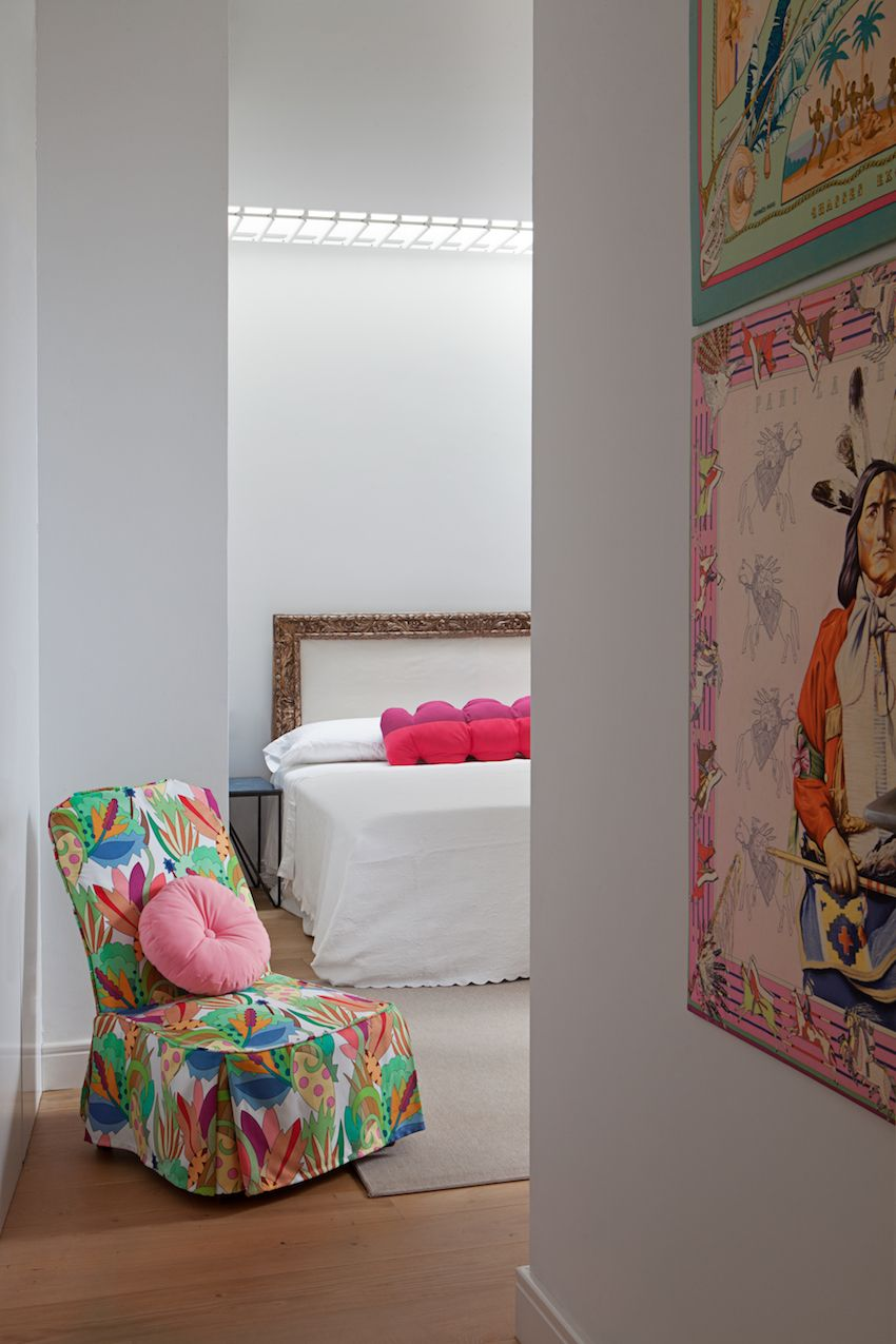 A multicolored slipper chair adds more punch to the room as you enter.