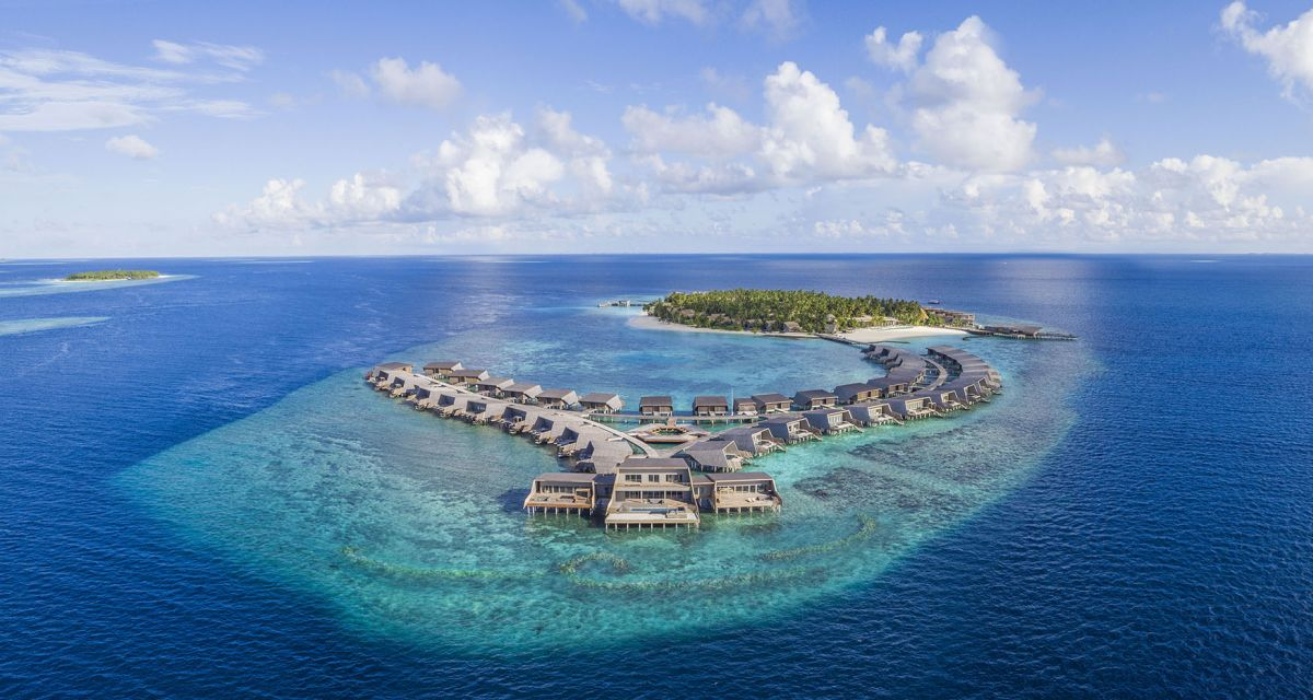 This luxury private island resort is a large house reef with villas stretching across the beach and the water