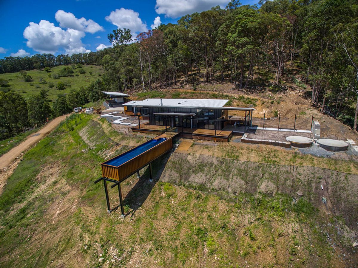 This split-level home is surrounded by wilderness, taming the landscape in a very friendly manner