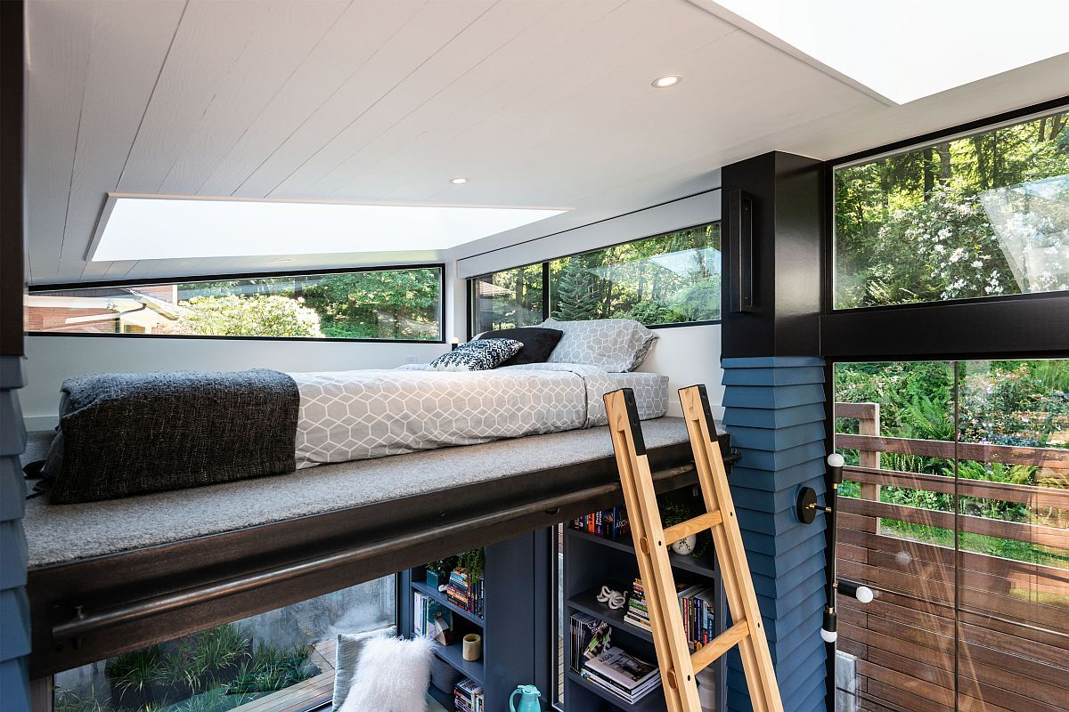 A ladder offers access to a secret loft bedroom which has its own source of natural light and views