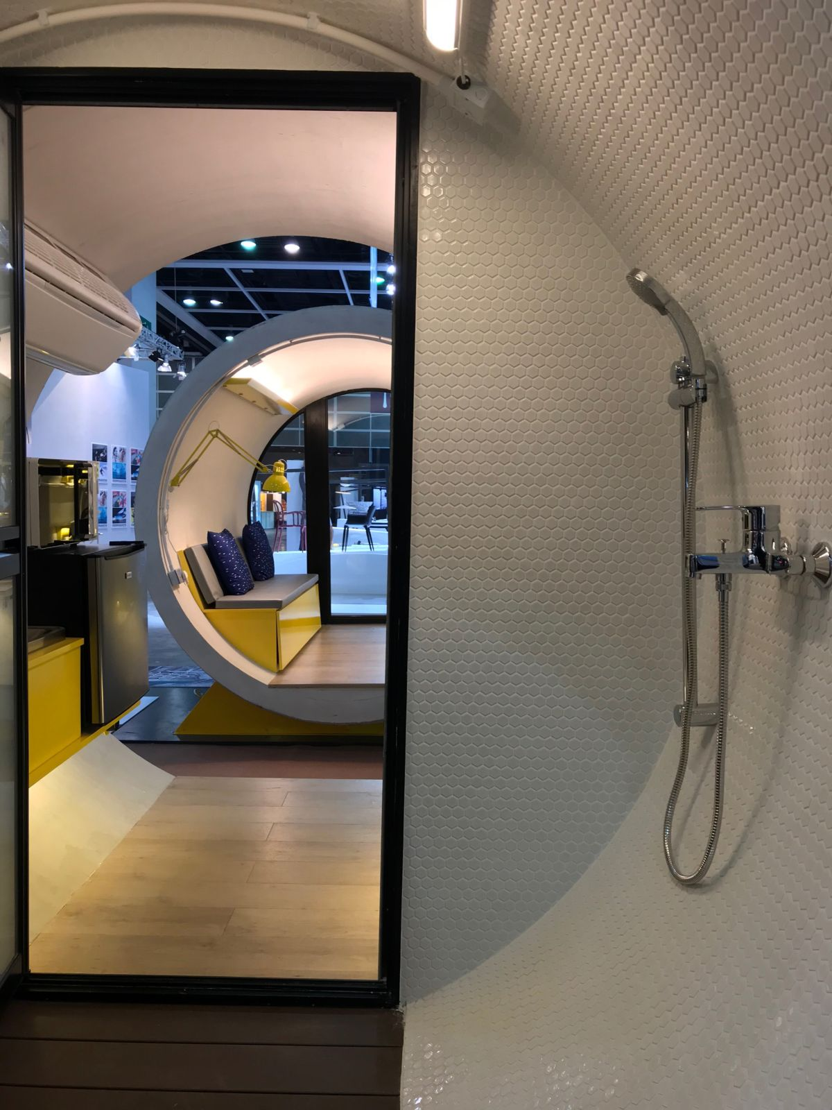The interior is small and has curved walls which in the bathroom are hovered in hexagonal tiles