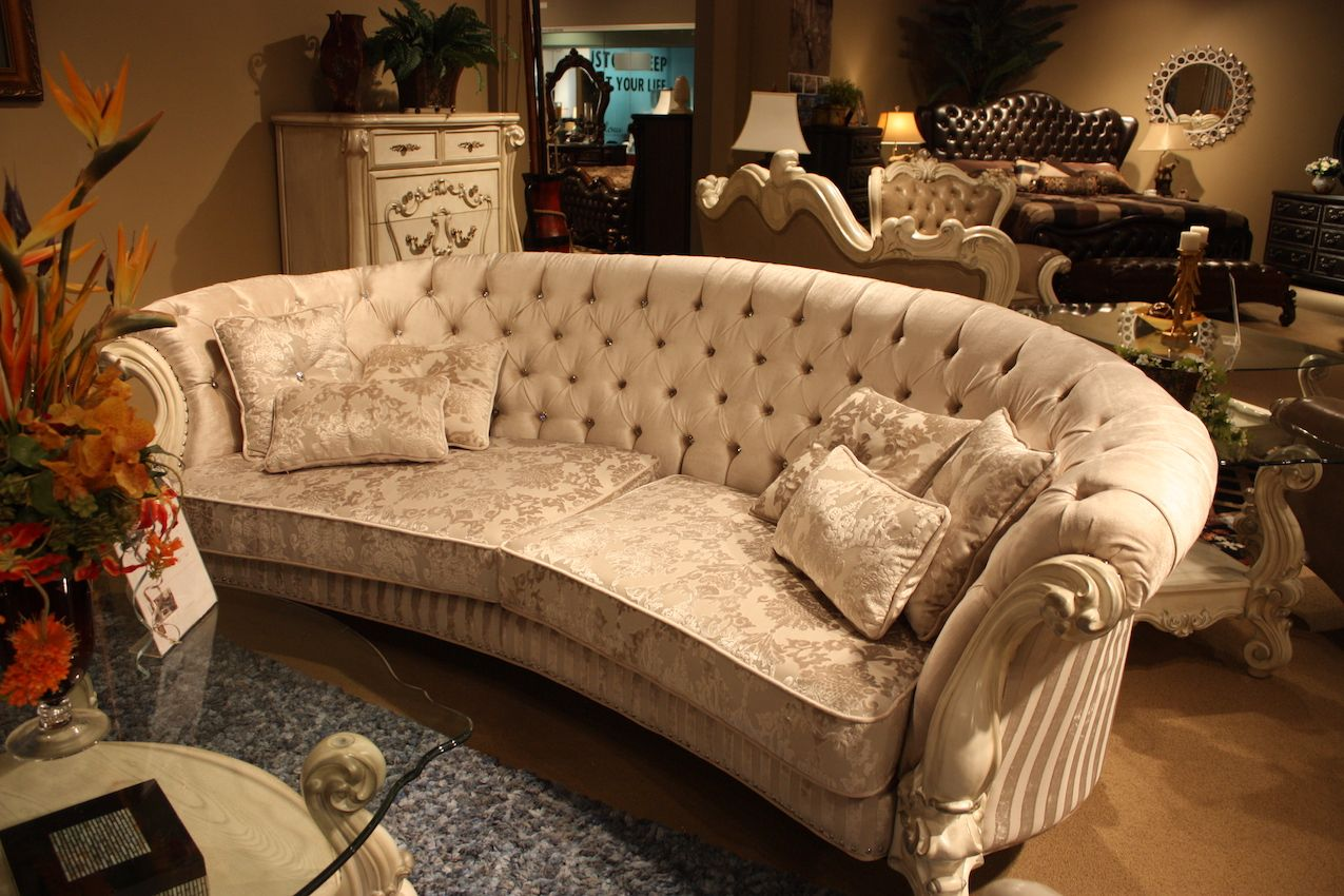 This type of sofa features the typical rolled arm, but it extends all the way around the back.