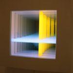 A neon artwork can create a sense of depth on a wall.