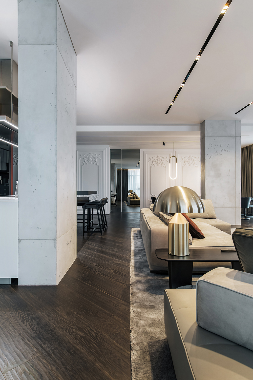 The living area dining room and the open kitchen form together the social zone and