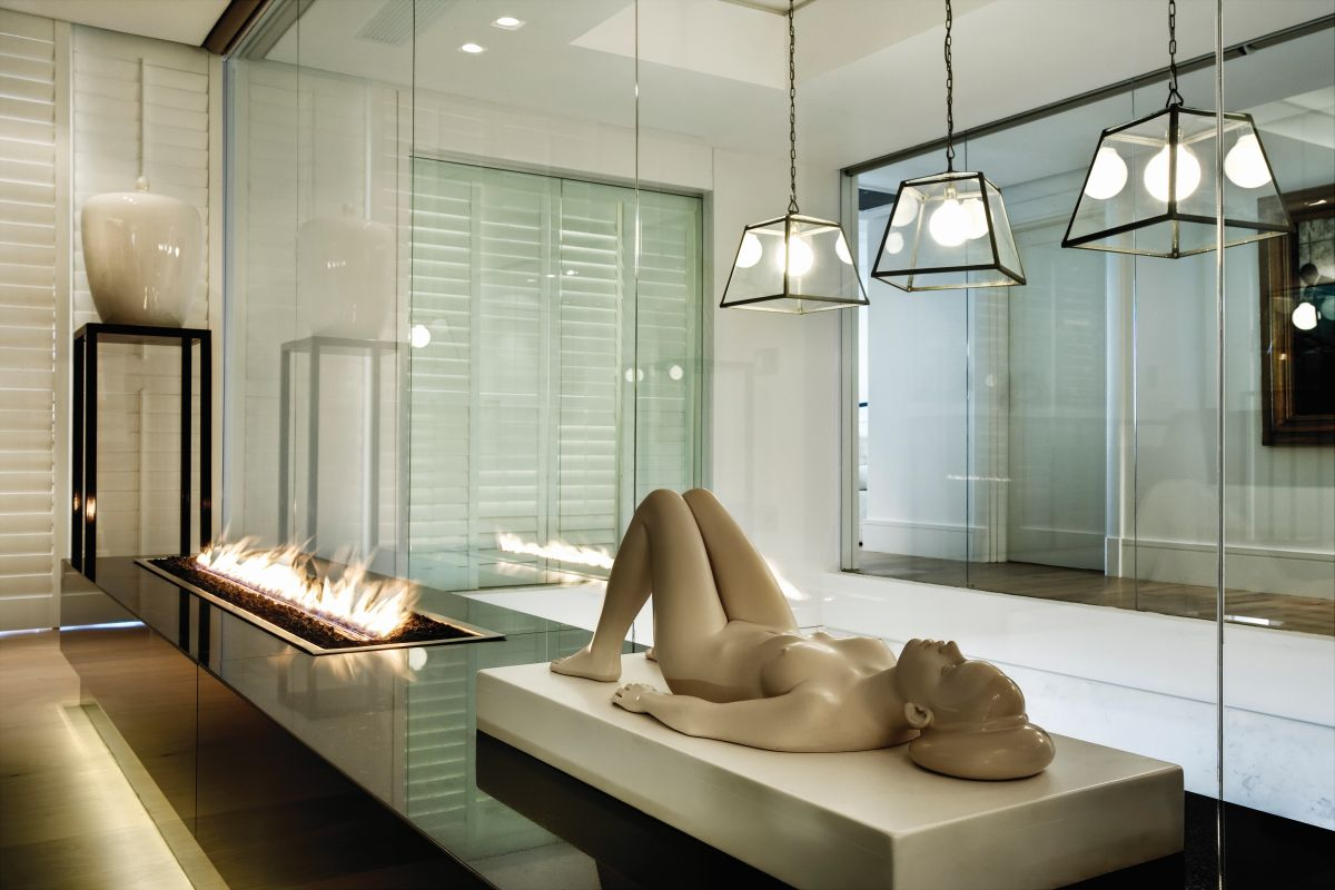 Numerous sculptures seamlessly blend in with the luxurious decor, adding a touch of opulence to the spaces