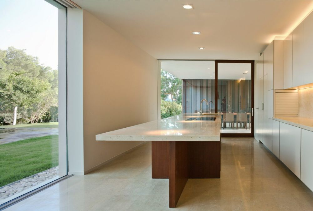 The kitchen is spacious and has its own special connection with the outdoors and to the adjacent internal areas