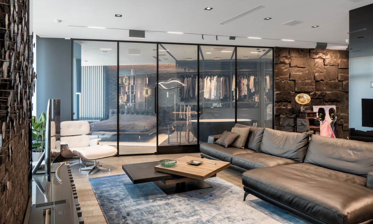 When the glass partitions are transparent, the entire apartment feels one huge open space
