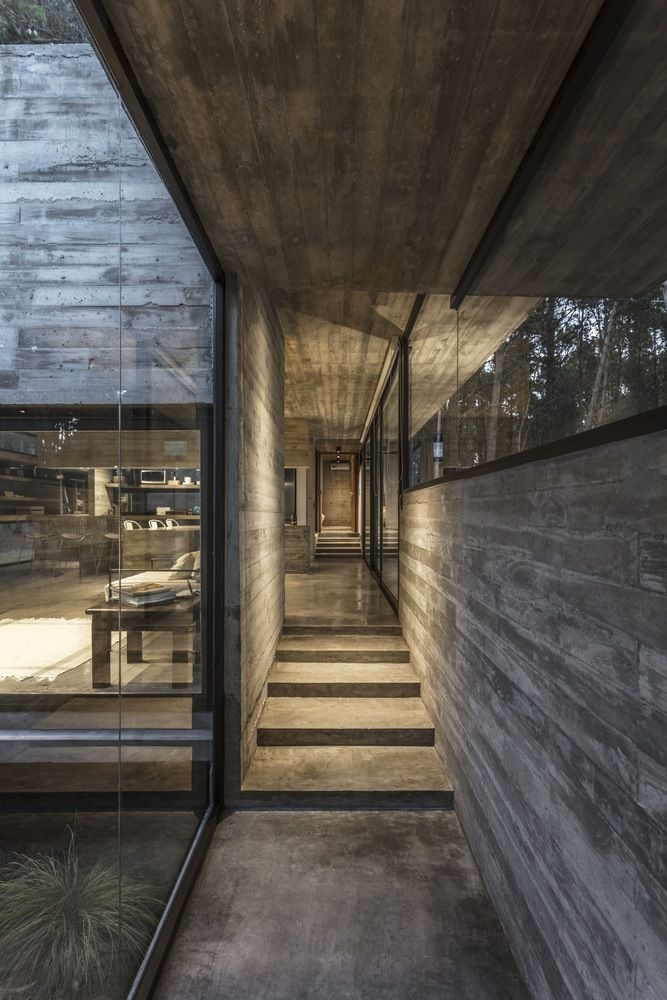 A circulation hallway connects the internal spaces on a longitudinal axis