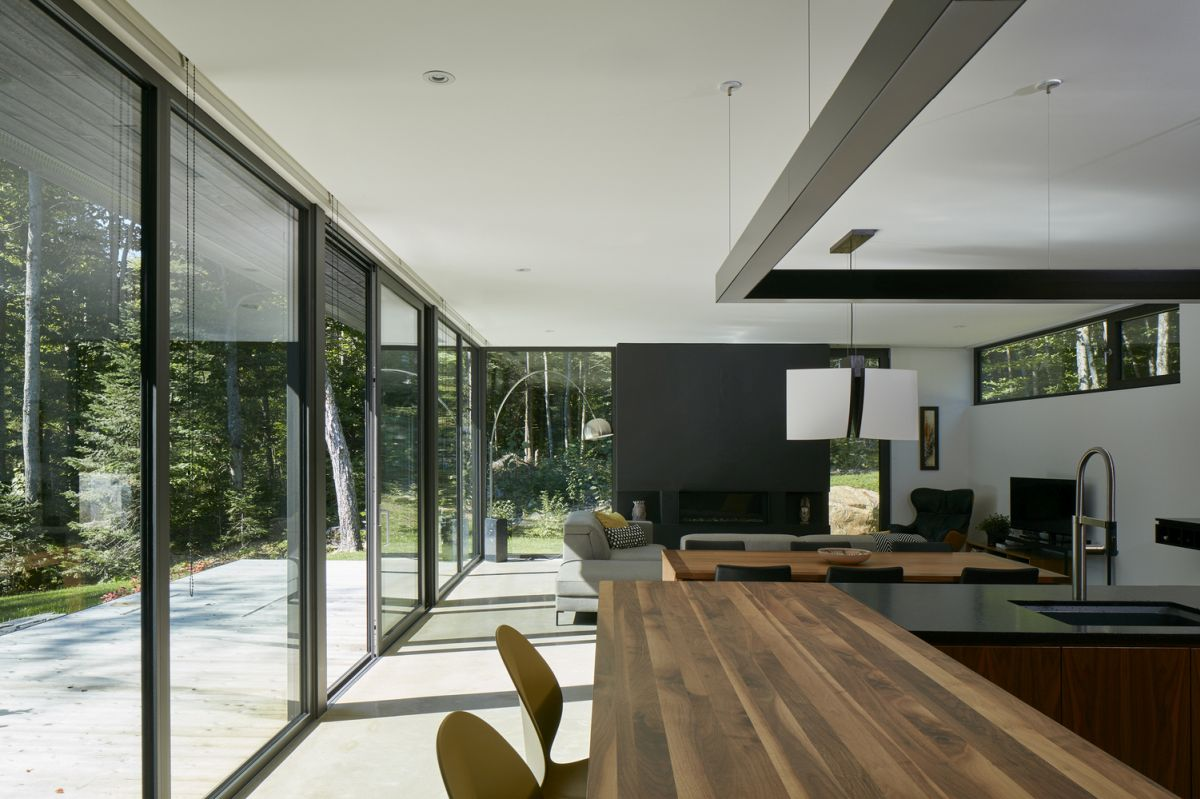 The sunny living area opens onto a porch and welcomes natural light and lake views inside