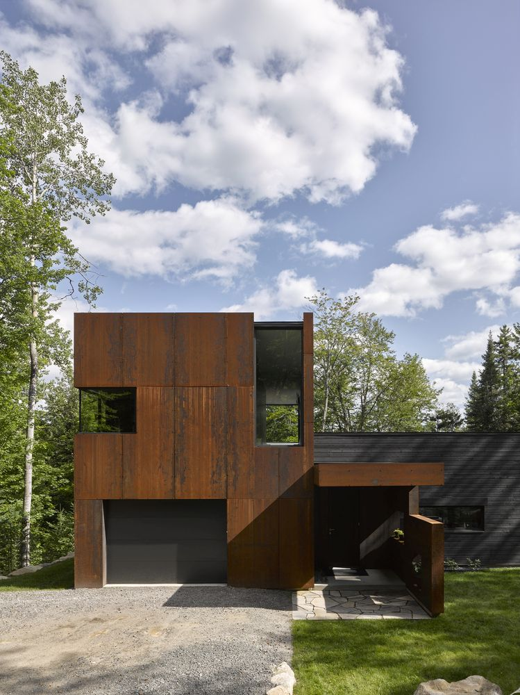 The corten steel facade already has a weathered look and will change color over time to better blend in with nature