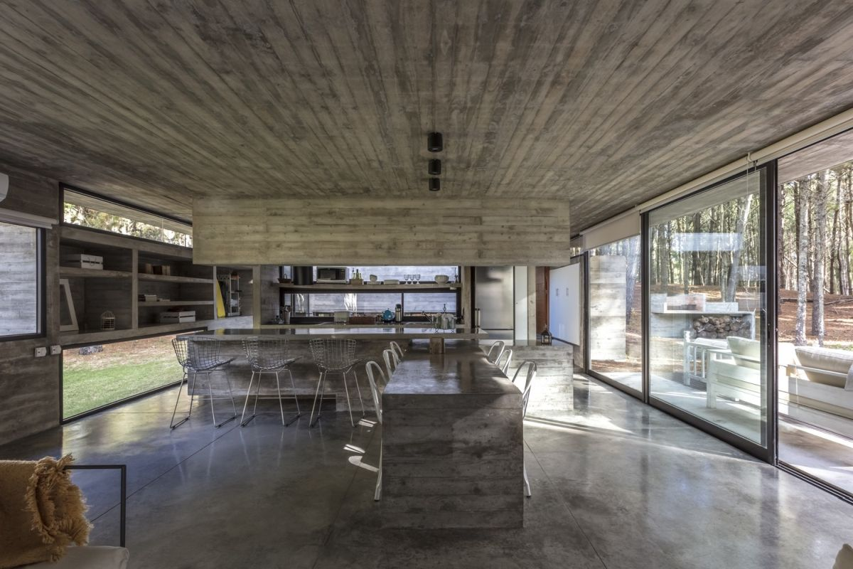 Polished concrete floors visually connect the spaces and also help to maintain simplicity throughout the house