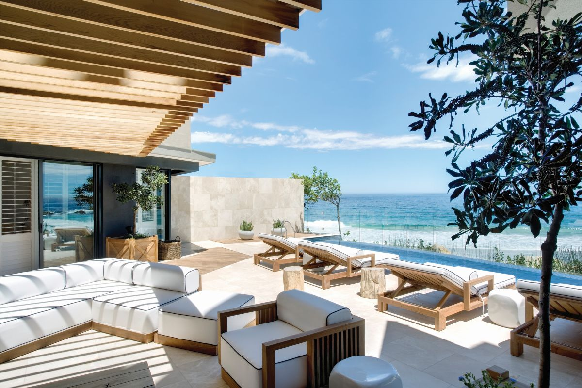 The outdoor pergola and the terrace spaces act as extensions of the indoor living areas