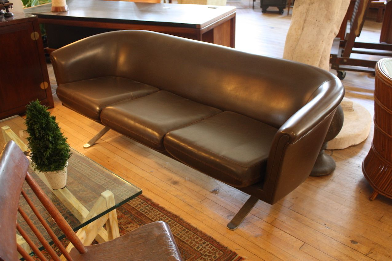 Vintage mid-century modern sofas are hot -- and expensive -- pieces of furniture.