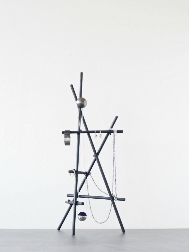 A sculptural design made with dowels and zip ties