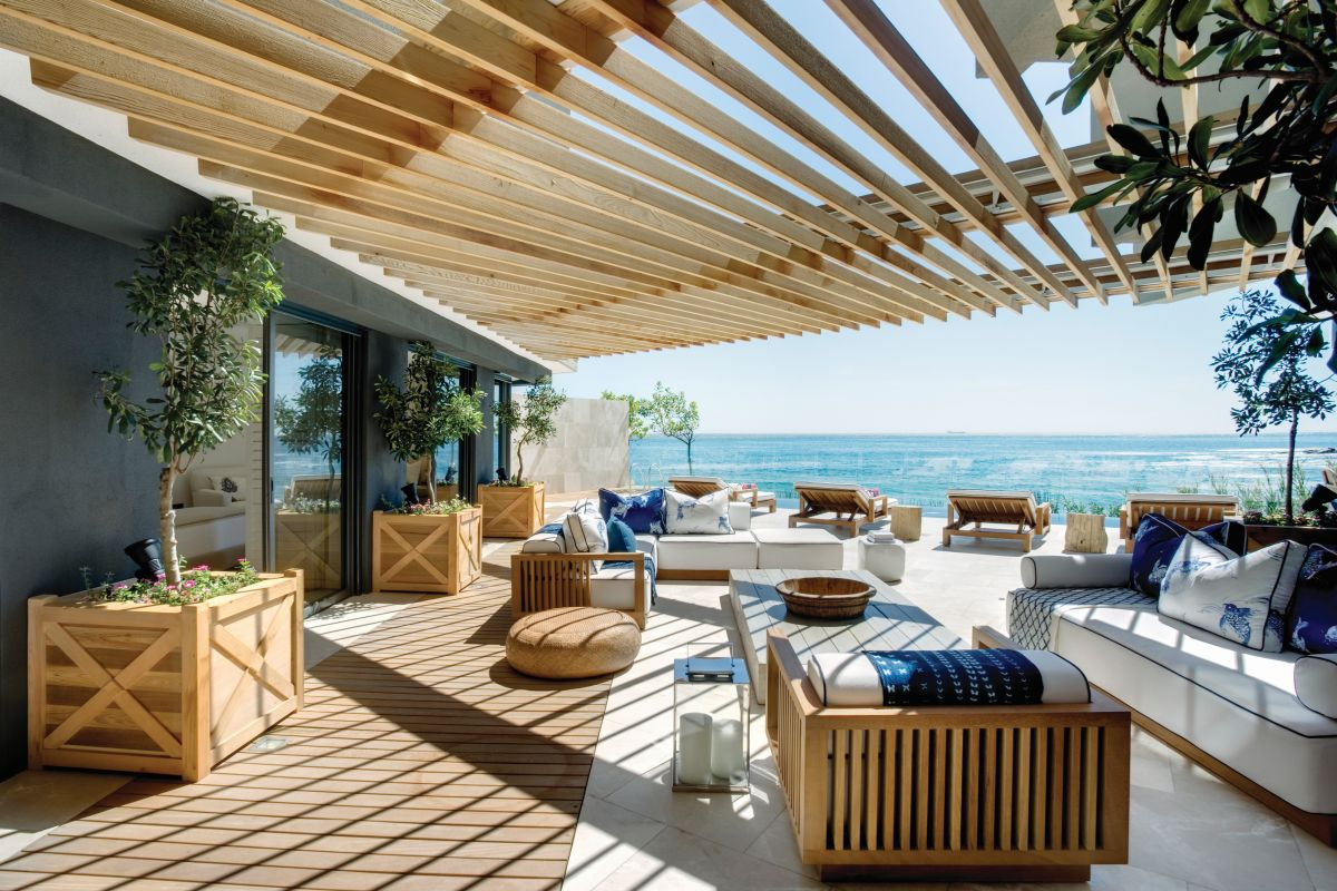 A large timber pergola extends the living spaces outdoors and offer magnificent views of the ocean and the blue sky