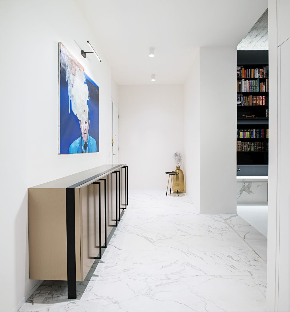 The entryway opens directly onto the living area and features marble flooring and a minimalist decor
