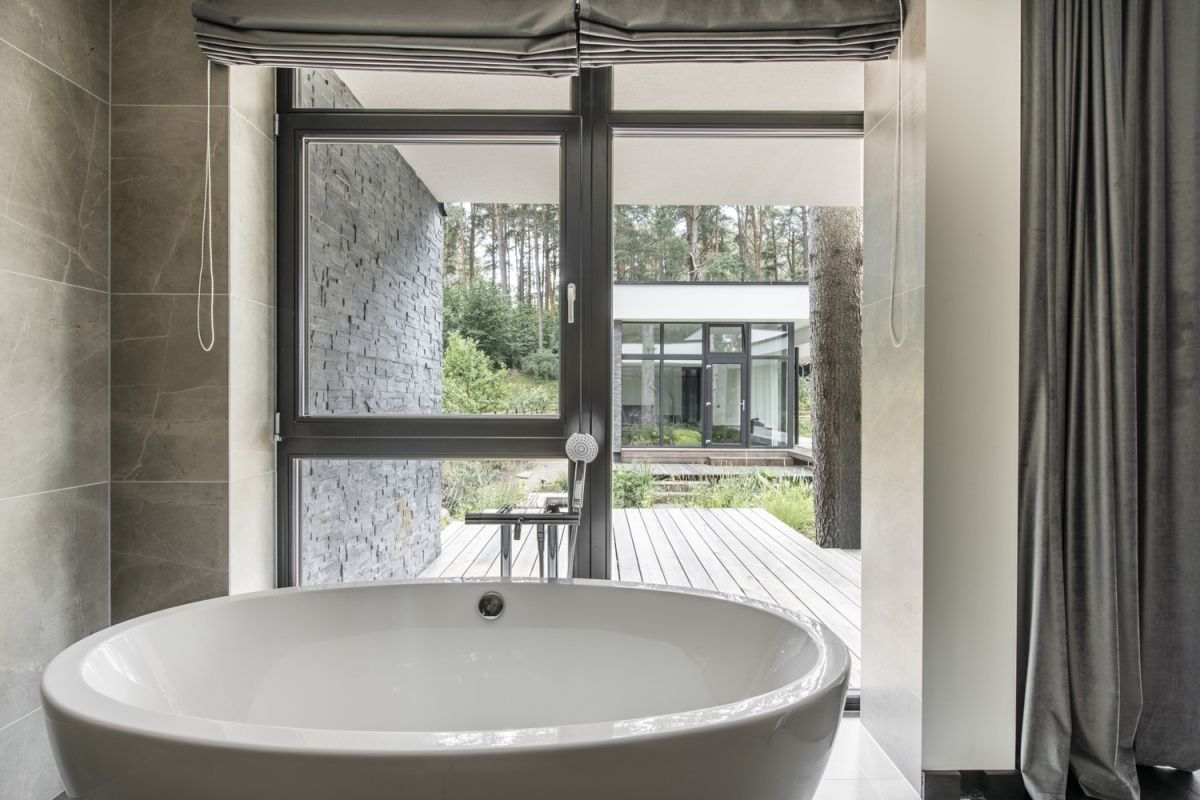 The designers tried to allow a cozy and calm atmosphere to define all the sections of the house, including the bathrooms