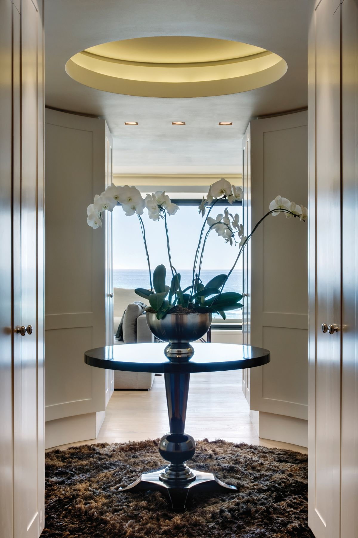 A circular lobby just off the master suite features an opening in the ceiling with built-in mood lighting