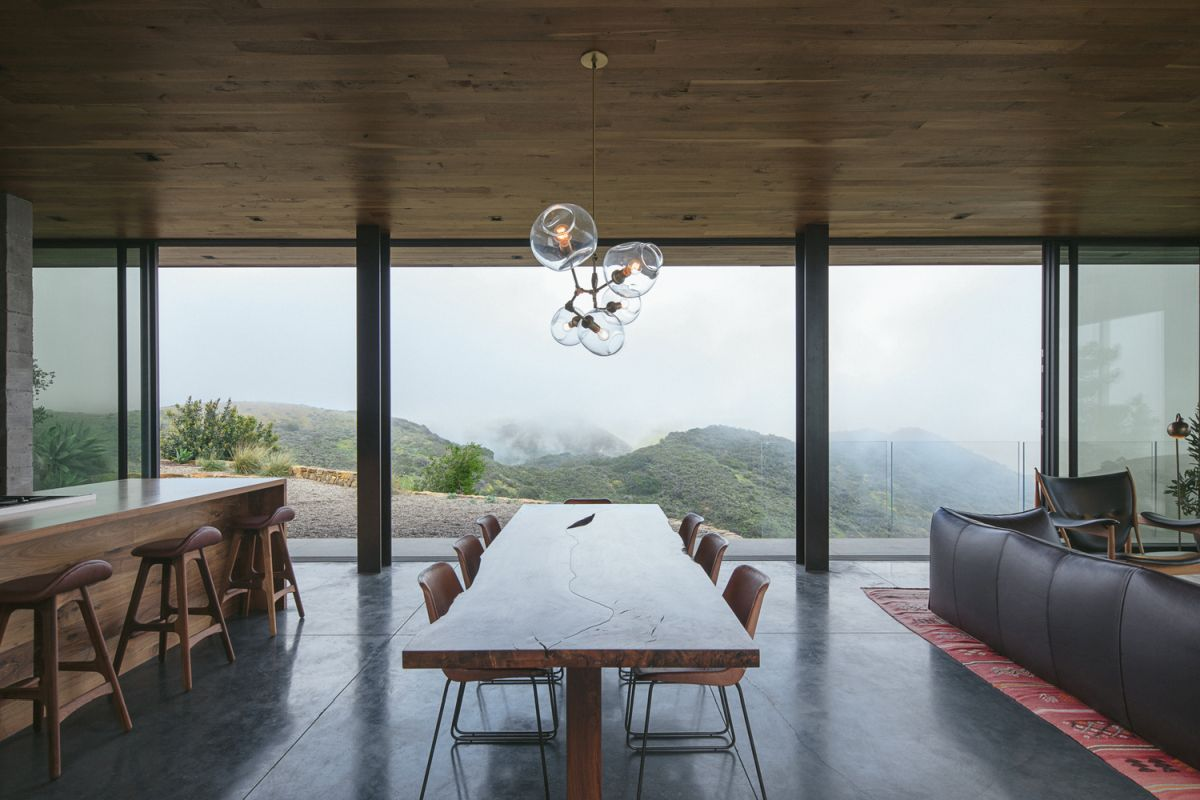 The kitchen, dining room and living area share an open floor plan with sliding glass doors that open onto a large deck