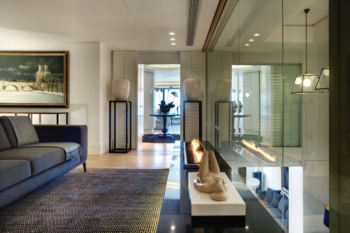 Soft fabrics, textured area rugs and classic shutters tone down the opulence and add warmth to the rooms