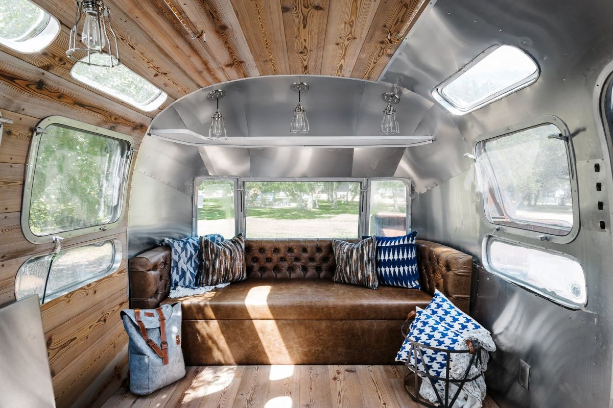 A new guest retreat was added by refurbishing a 1976 Airstream RV. The interior is a mix of wood paneling and silver surfaces