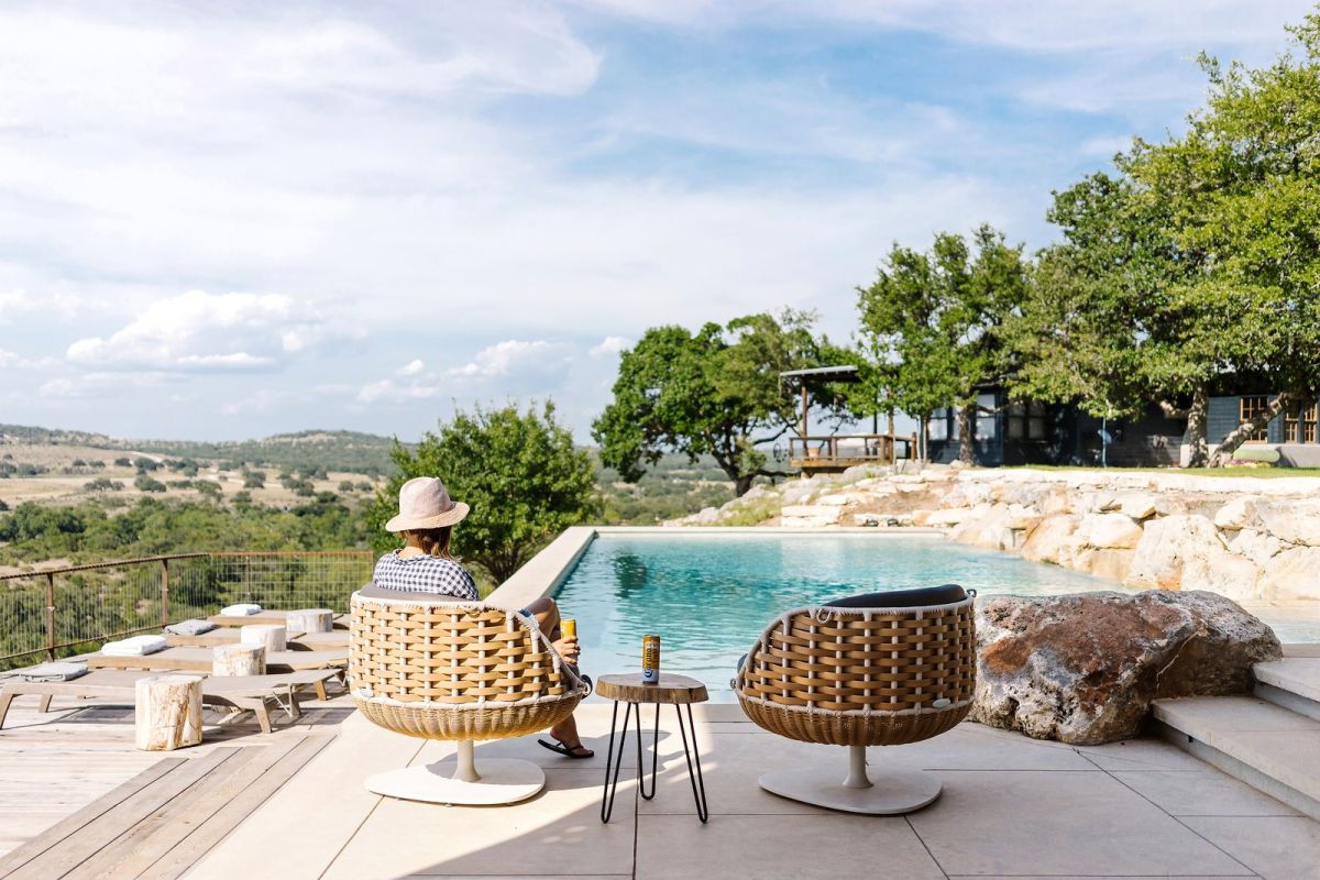 The poolside deck offers a pretty great view over the surrounding landscape as well