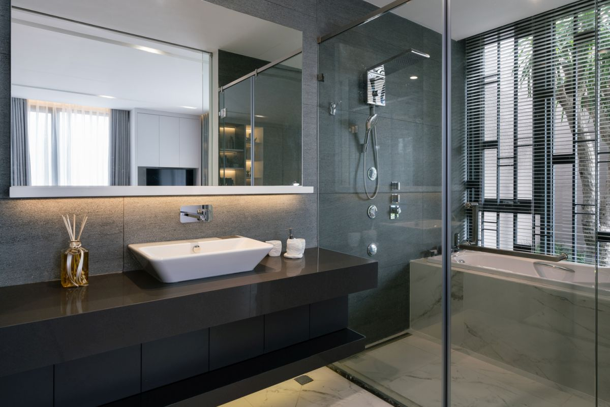 The bathrooms are open and airy too, featuring clear glass shower enclosures and large wall mirrors
