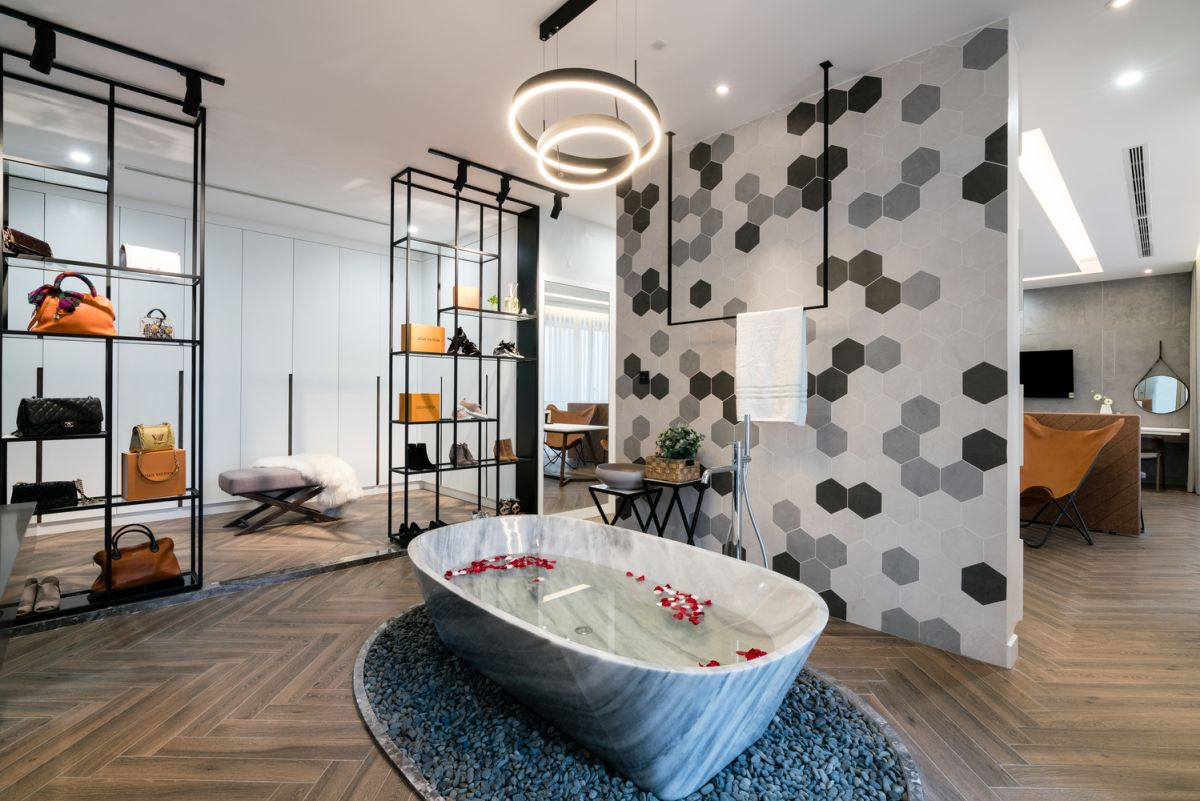 The master bedroom suite features a sculptural tub as part of an open bathroom design