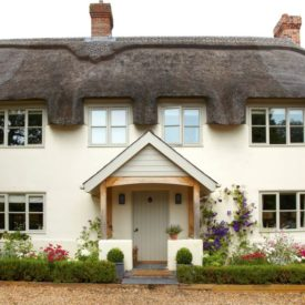 Tthatched roof Cottage Style Home