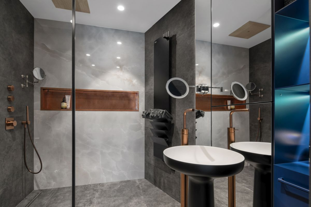 The master bathroom has a large full height mirror which makes it appear larger and more open