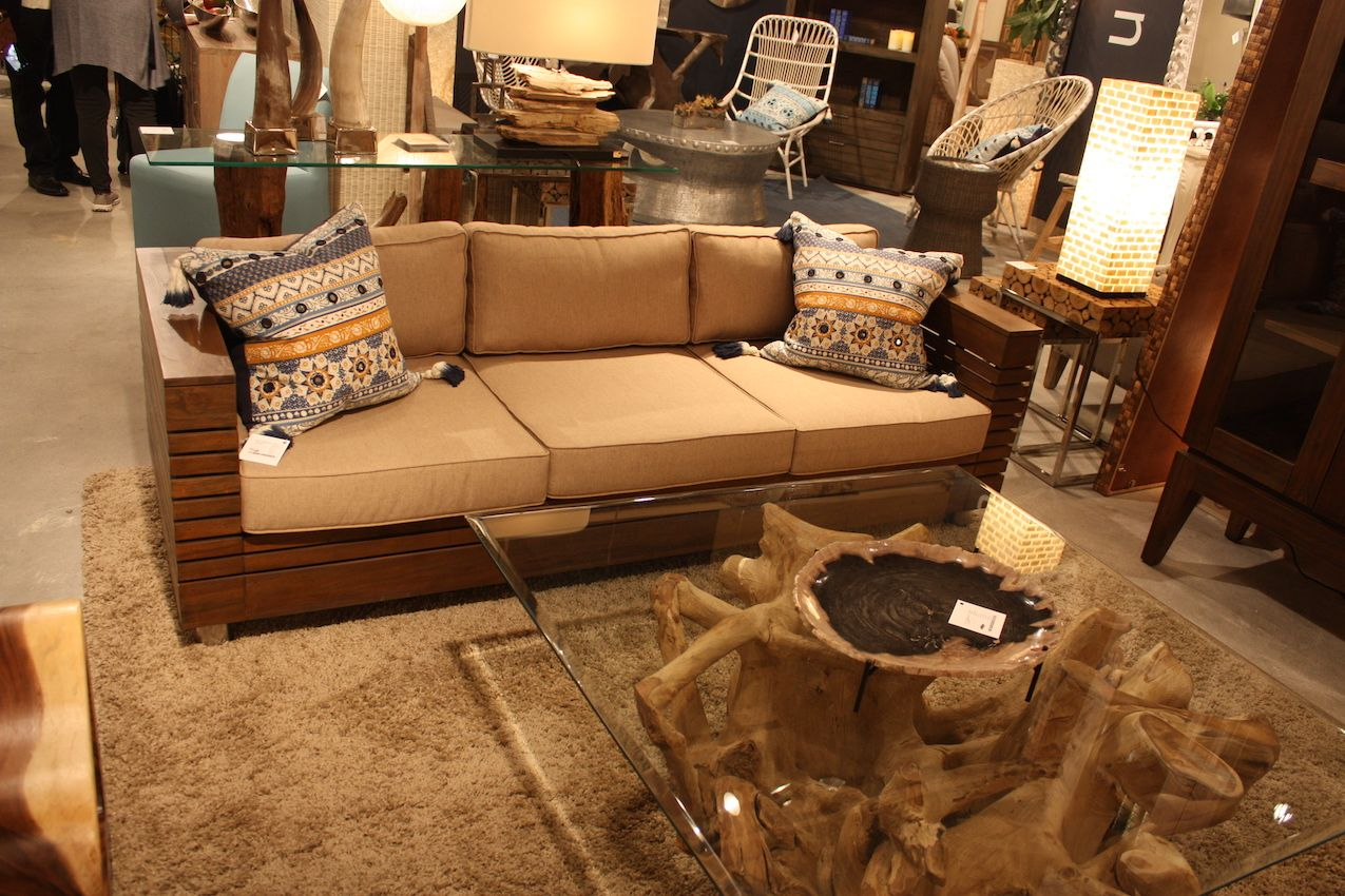 Sofas with wooden arms are best for a living room or office.