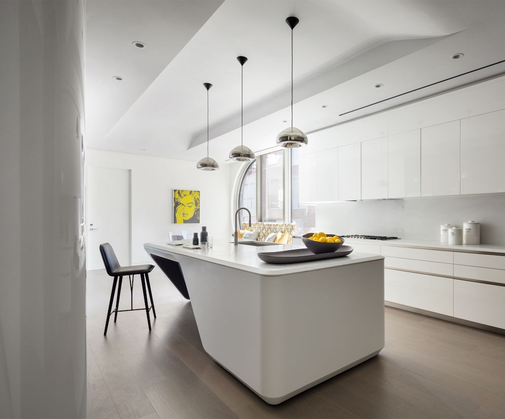 The unique kitchen island adds interest to the otherwise linear space.