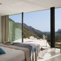 Bedroom with a large porch by Miquel Lacomba Architect
