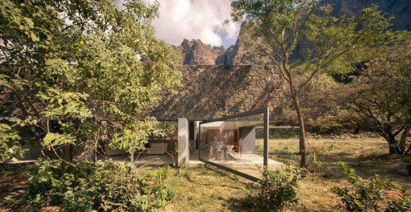 A Volcanic Rock House Seamlessly Disappears Into The Landscape