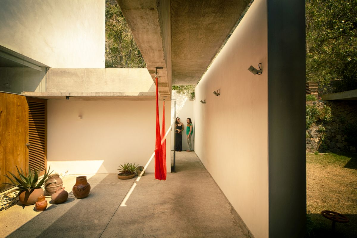A private courtyard is actually a natural extension of the private volumes