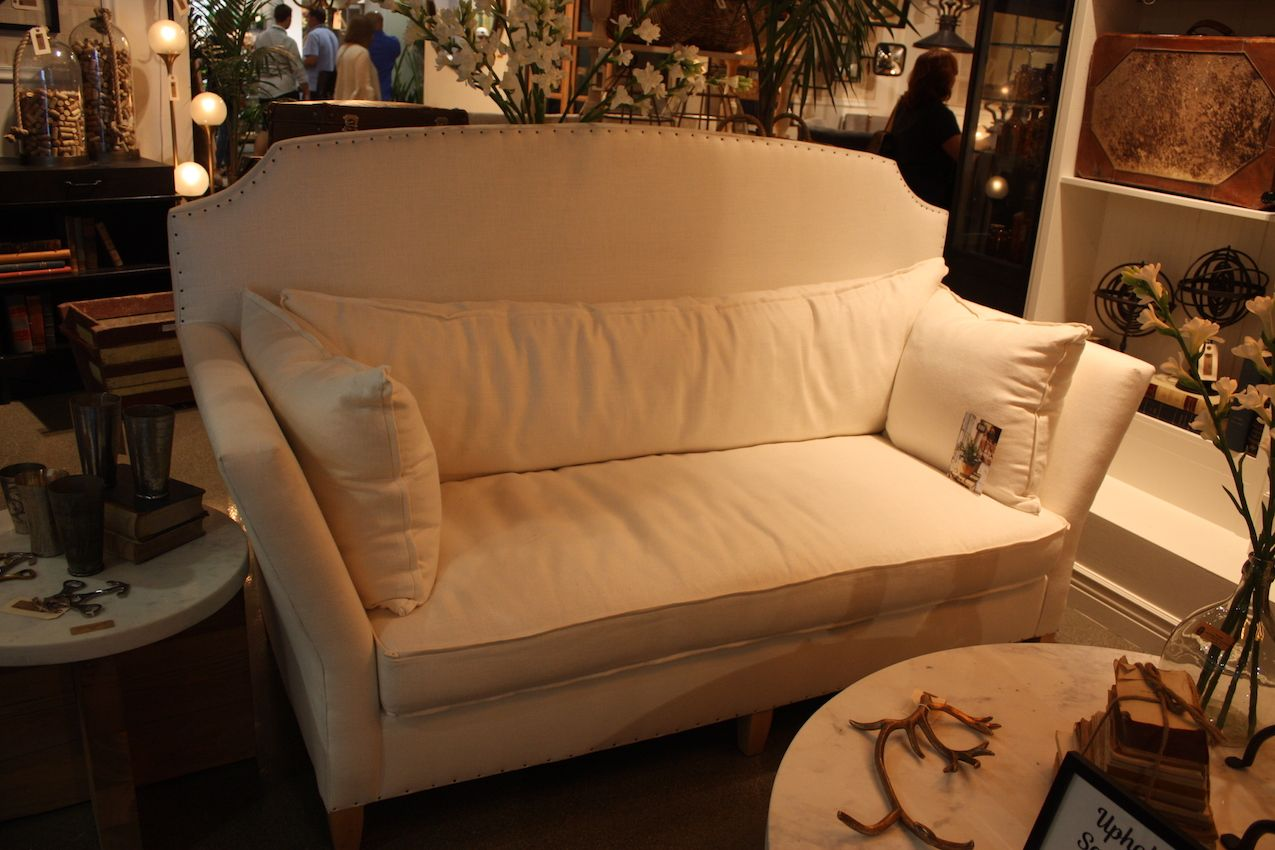 Palecek's slip-covered sofa is ideal for a cottage style space.