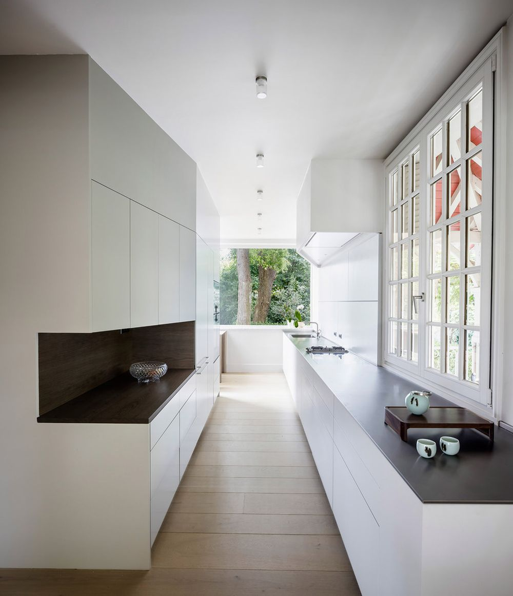 The kitchen is long and narrow and has large windows which let in lots of natural light