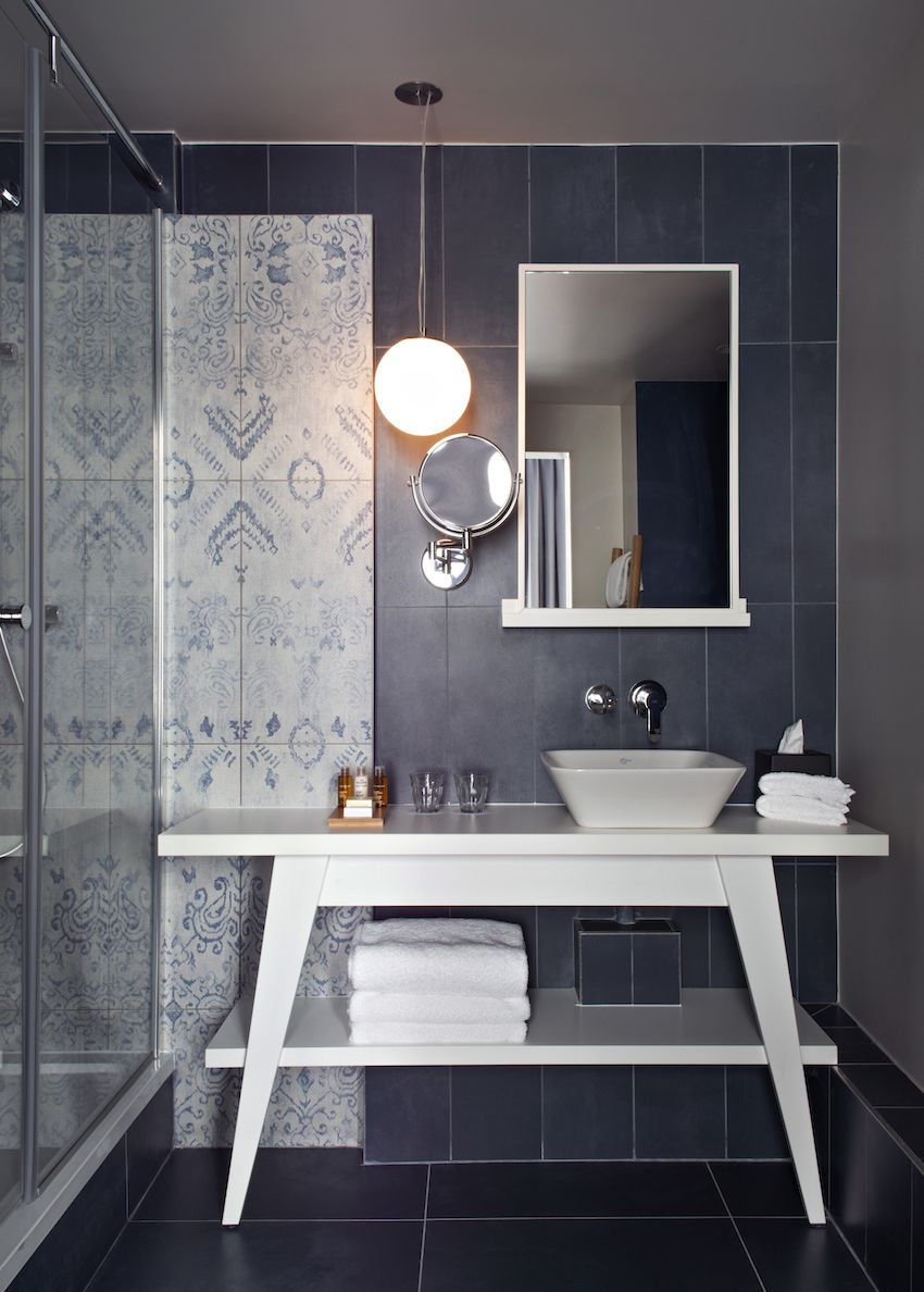Bathrooms have a tranquil color scheme and stylish elements.