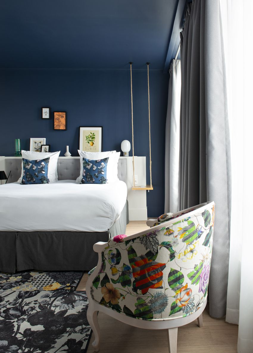Printed upholstery and rugs add vibrancy to the rooms without overpowering the calm atmosphere.