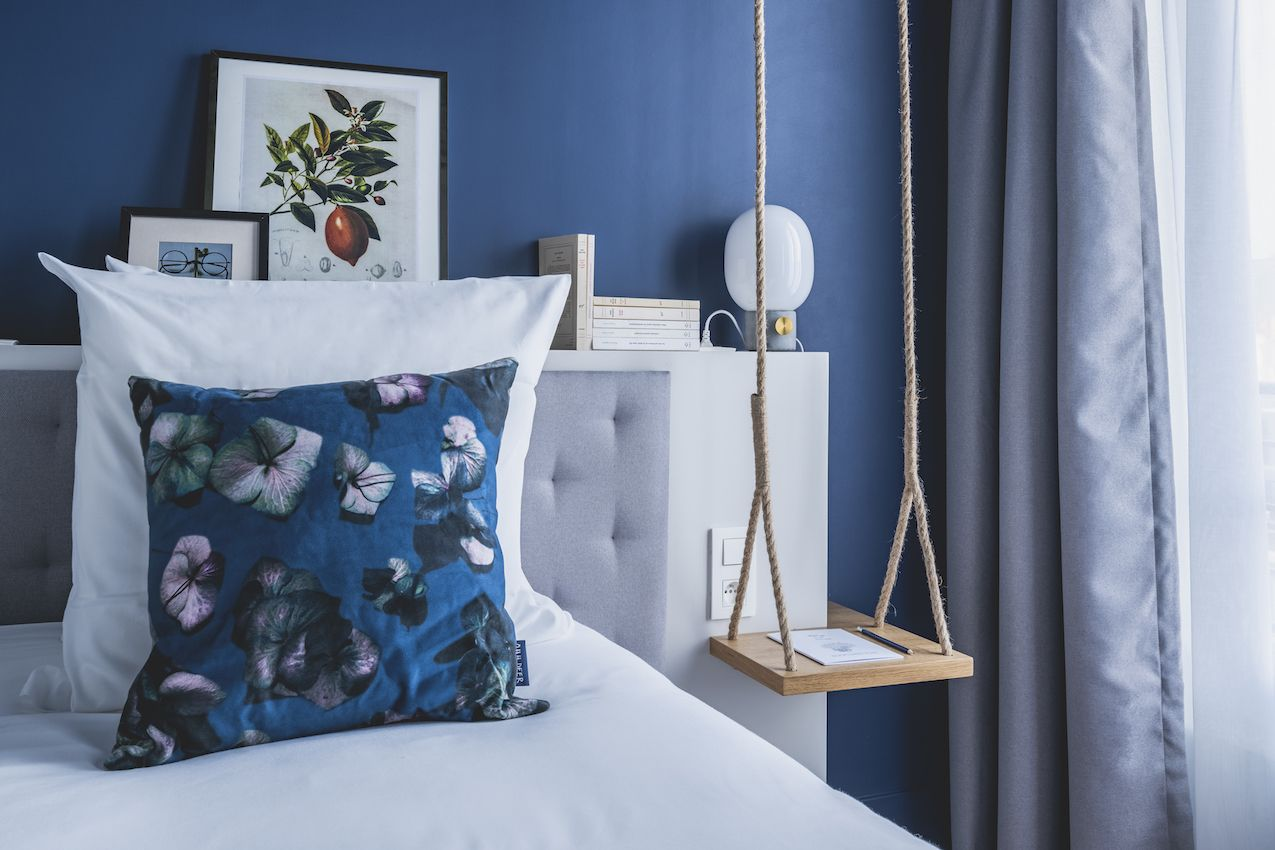 Funky pieces like the swing nightstand are unlike other standard hotel decor items.