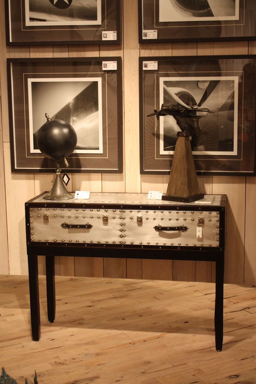Industrial pieces like this console from Mercana can be new reproductions or upcycled factory items.