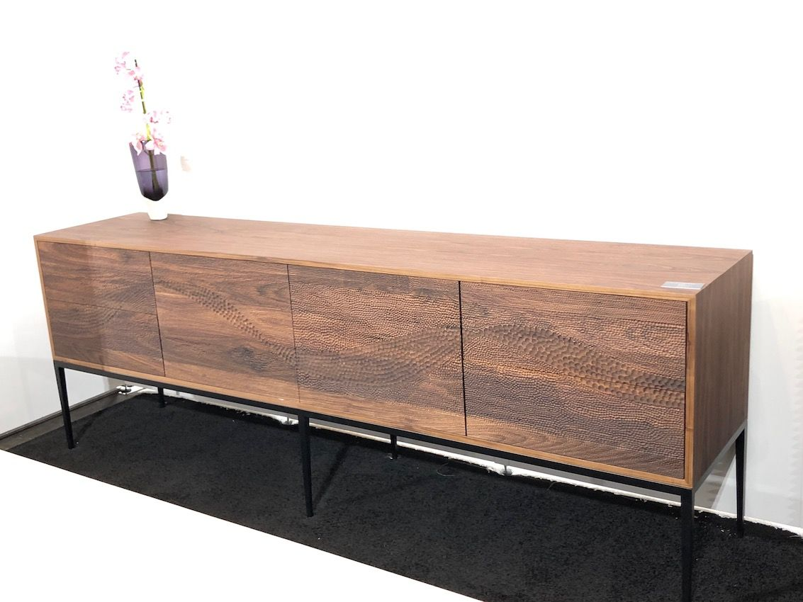 Cabinet's credenza has the lines typical of a mid-century modern piece.