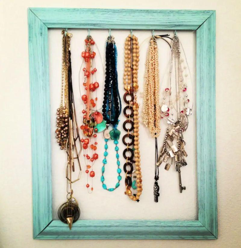 Repurposed frame organizer for necklaces