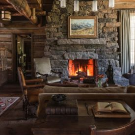 Rustic mountain home with a beautiful traditional living featuring large stone fireplace